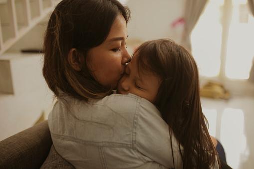 kid sleep on her mother arms