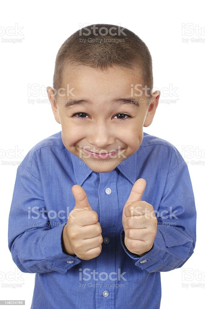 kid smiling giving thumbs up royalty-free stock photo