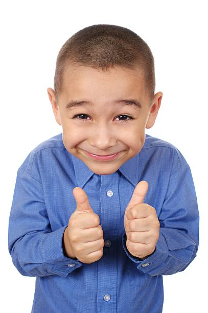 kid smiling giving thumbs up stock photo