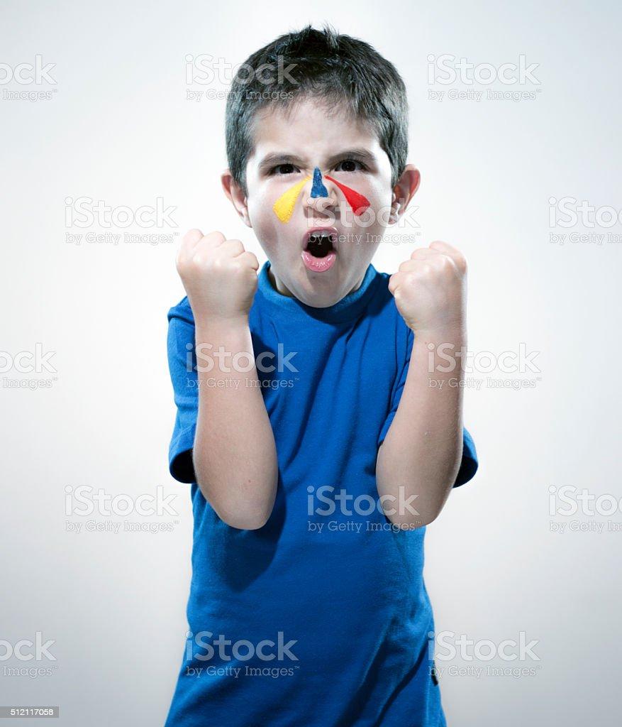 Kid soccer fan stock photo