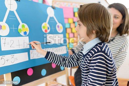 istock Kid Solving Math Exercises 1025873440