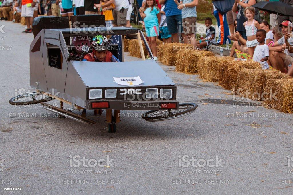 Kid Steers Delorean Mockup In Atlanta Soap Box Derby Event stock photo