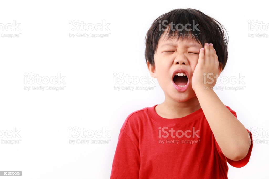 Kid suffering from toothache stock photo