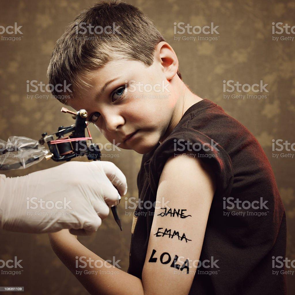 Kid tattooed stock photo