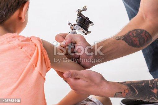 istock Kid tattooed 493763448