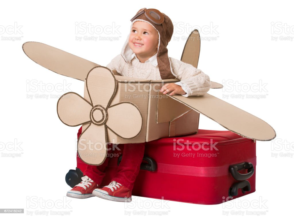 Kid Travel on Toy Airplane, Child Sitting on Suitcase, Luggage Fly as Plane, Baby Pilot stock photo