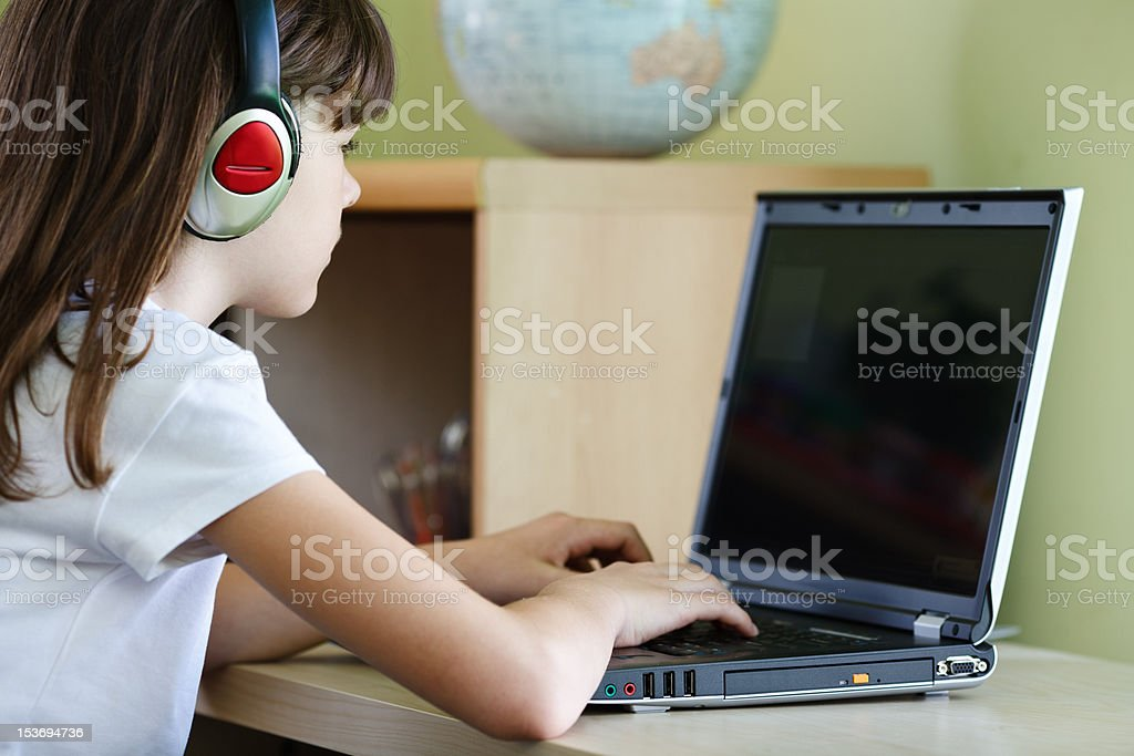 Kid using computer royalty-free stock photo