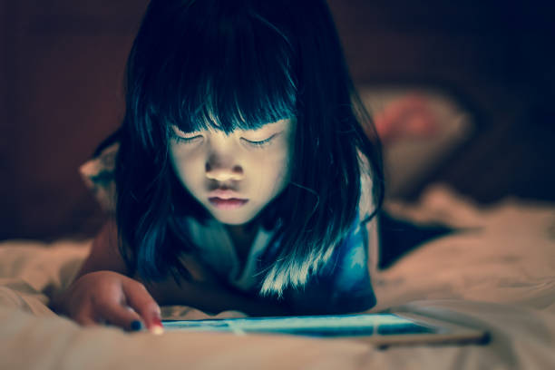 Kid using tablet for online learning at home. stock photo