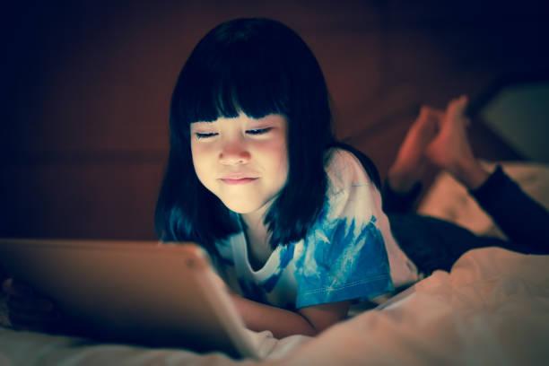 Kid using tablet online communicate social network. stock photo