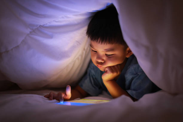 Kid using tablet play learning application stock photo