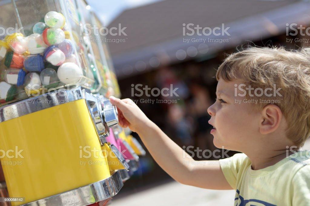 Kid using vending toys stock photo