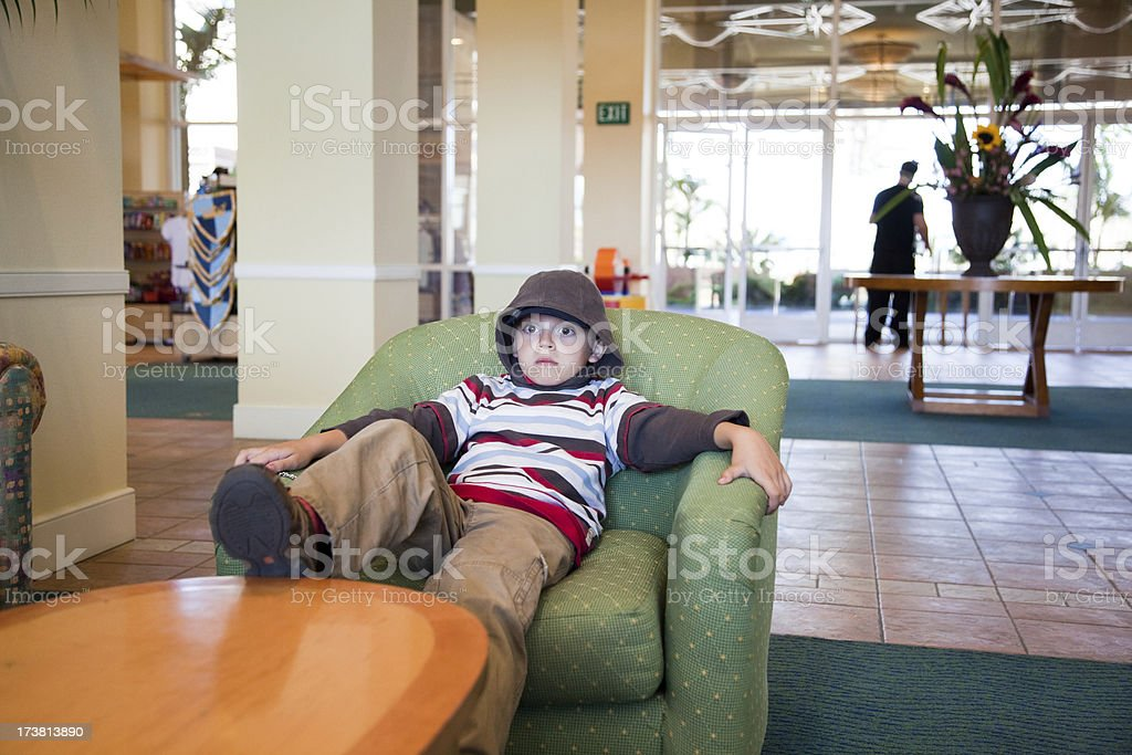 Kid Waiting in a Lobby royalty-free stock photo