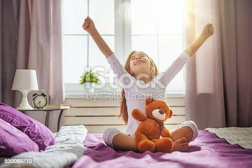 istock Kid wakes up from sleep. 830089710