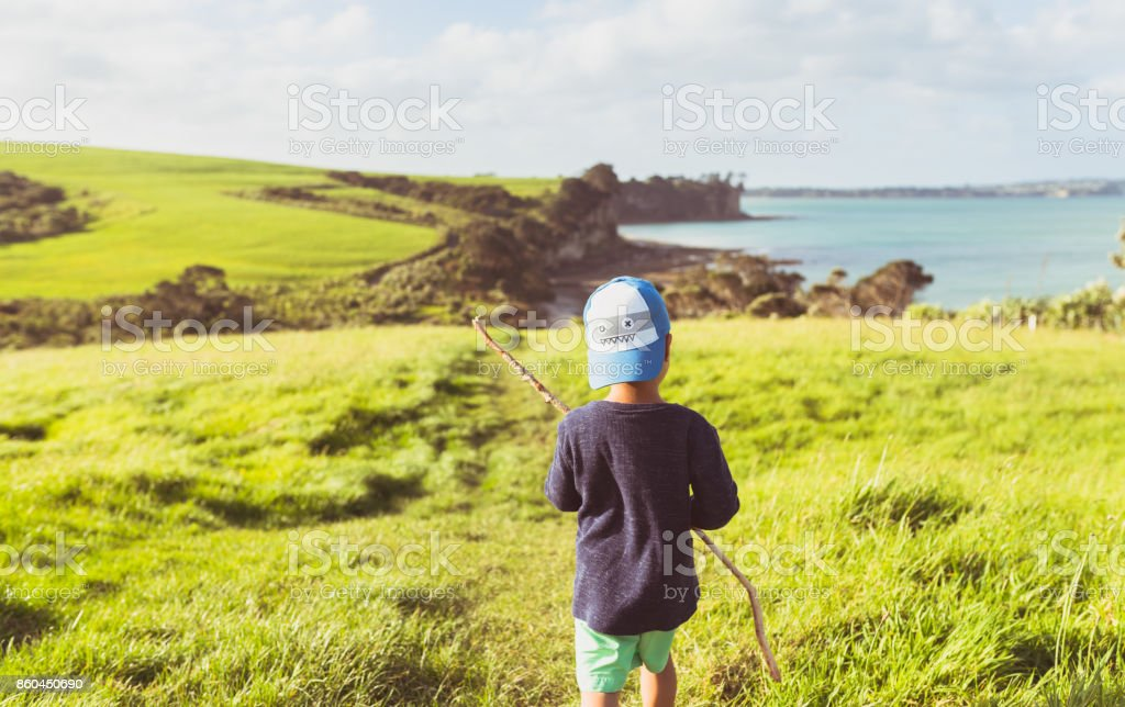 Kid Watching at view in Long Bay, Auckland, New Zealand. stock photo