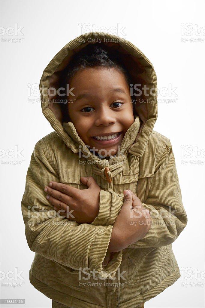 kid wearing hood stock photo