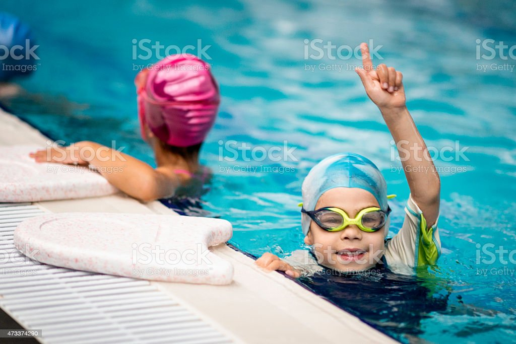 Kid who won the swimming race stock photo