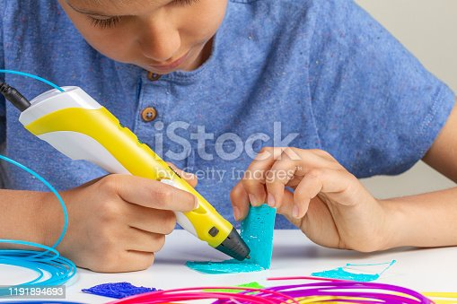 899701486 istock photo Kid with 3d pen creating new item 1191894693