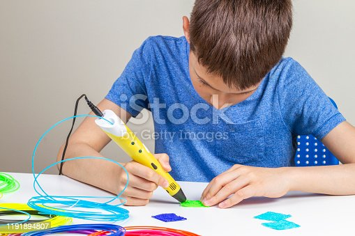 1082038948 istock photo Kid with 3d pen creating new item 1191894807