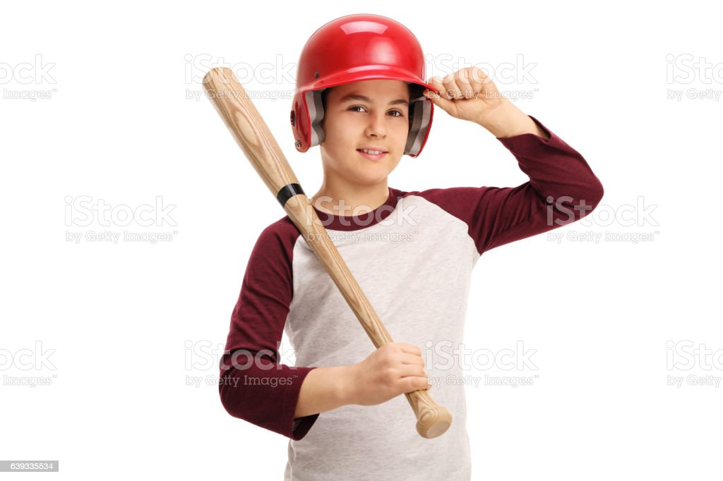 Kid with a baseball bat and a helmet stock photo