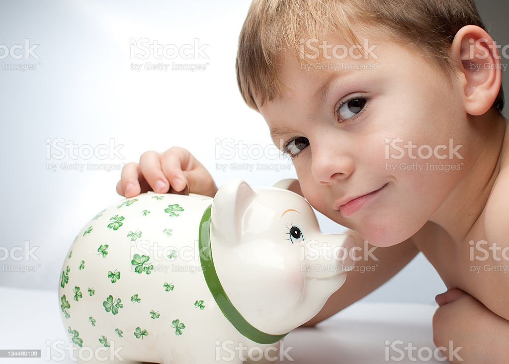 kid with a piggy bank royalty-free stock photo