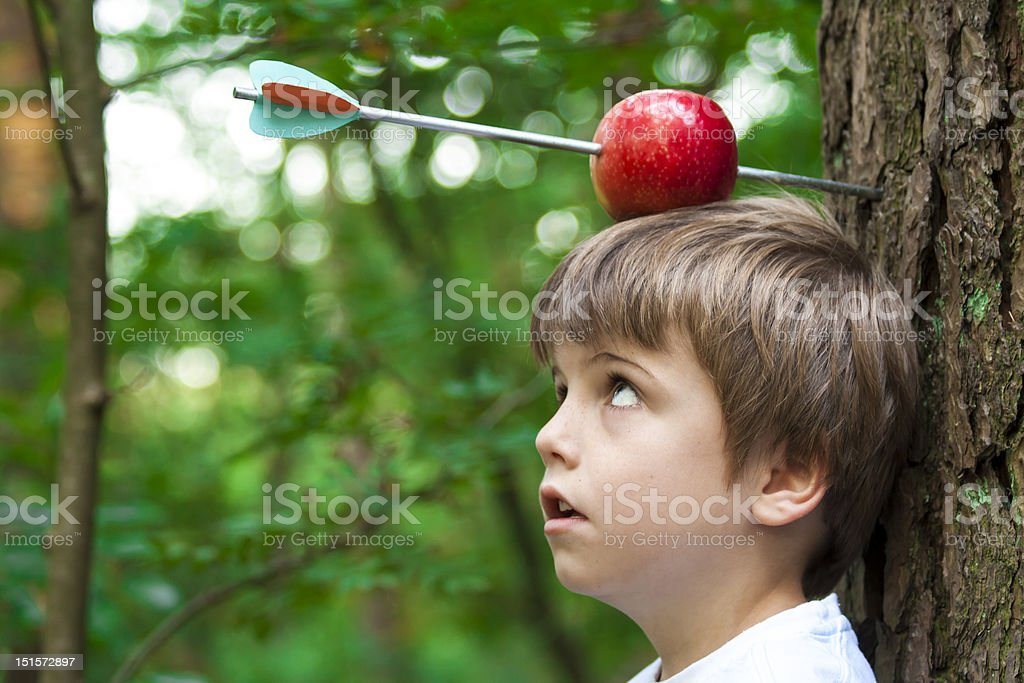 kid with apple on head royalty-free stock photo