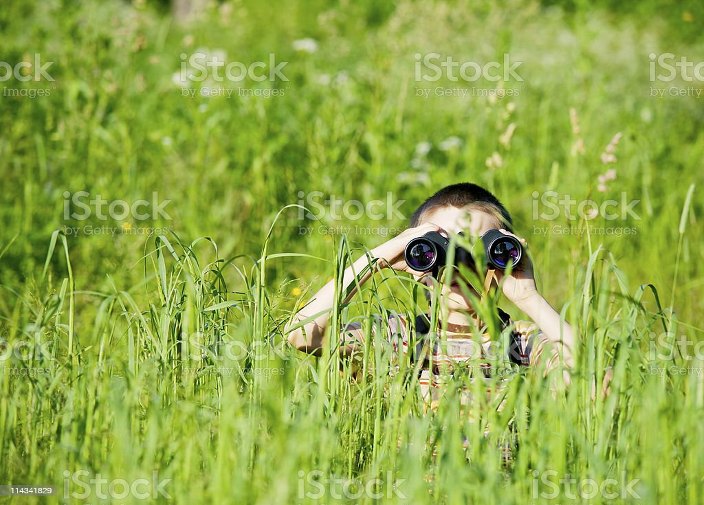 Kid with binocular royalty-free stock photo