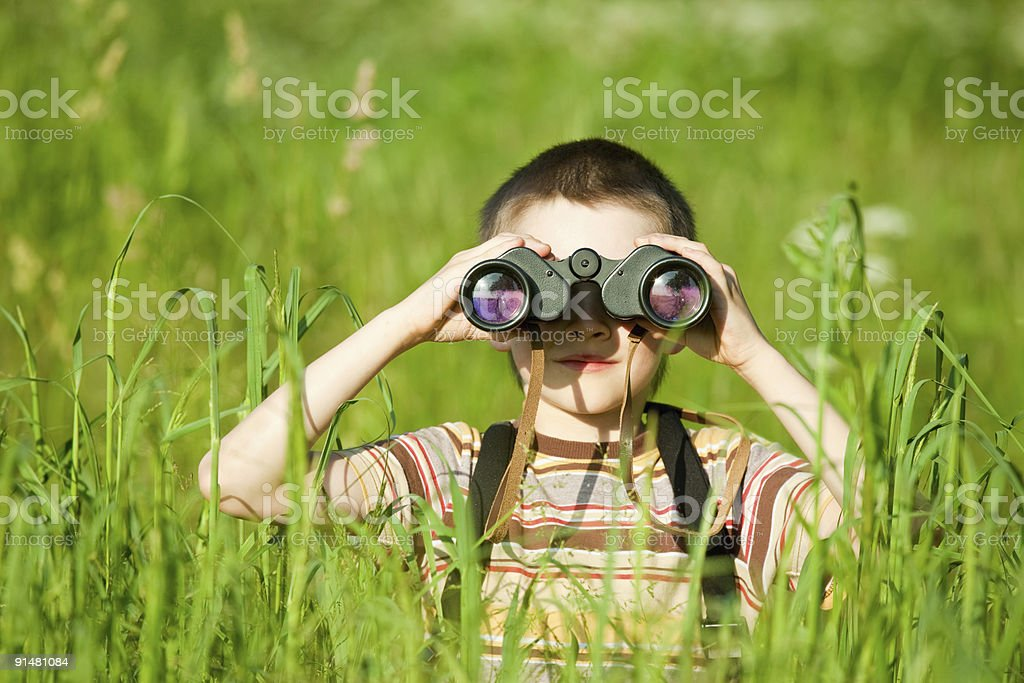 Kid with binocular stock photo