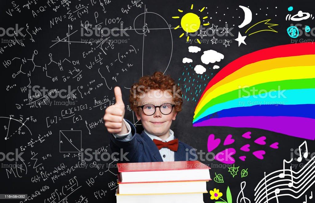 Kid with books having fun