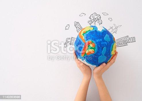 istock Kid with globe. 1140353595