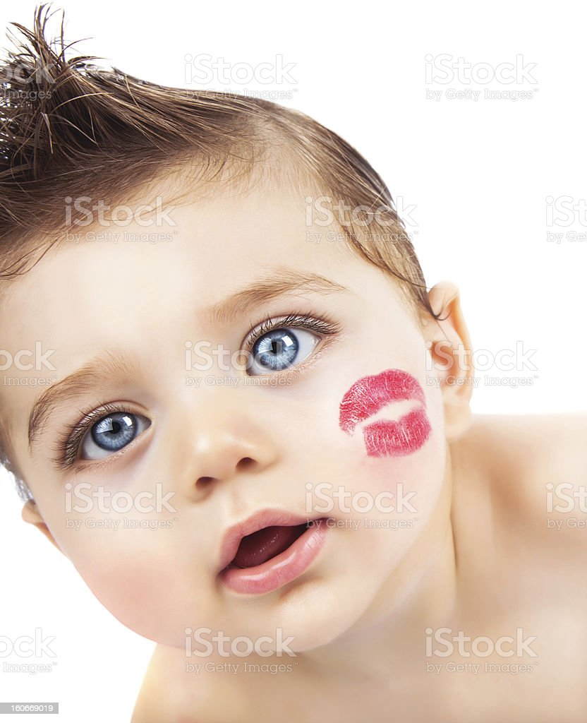 Kid with kiss stock photo