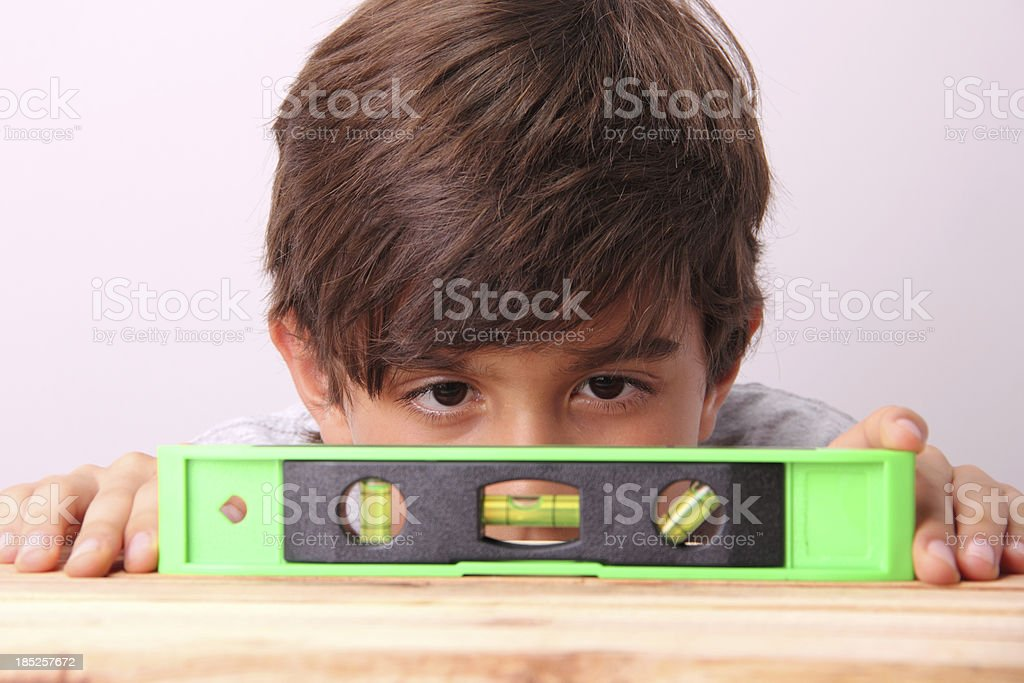 Kid With Level royalty-free stock photo