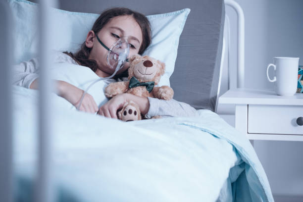 Kid with oxygen mask stock photo