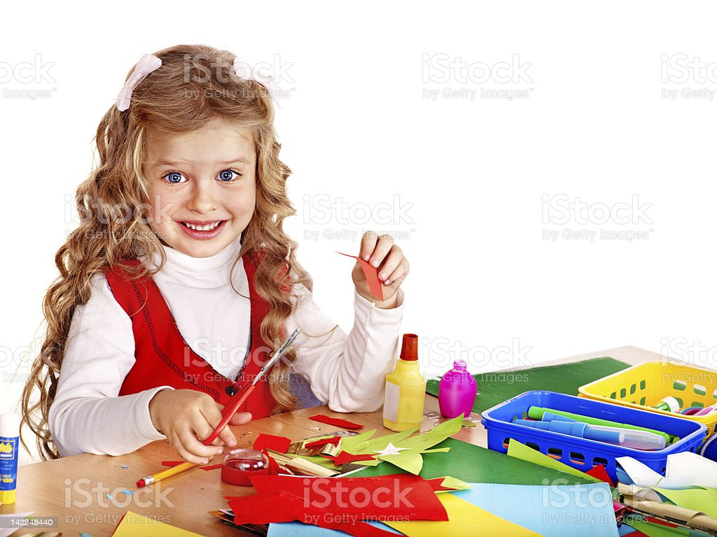 Kid with scissors and glue. stock photo