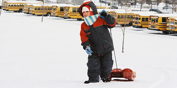 Kid with sled Sledding in Vaughan grifare stock pictures, royalty-free photos & images