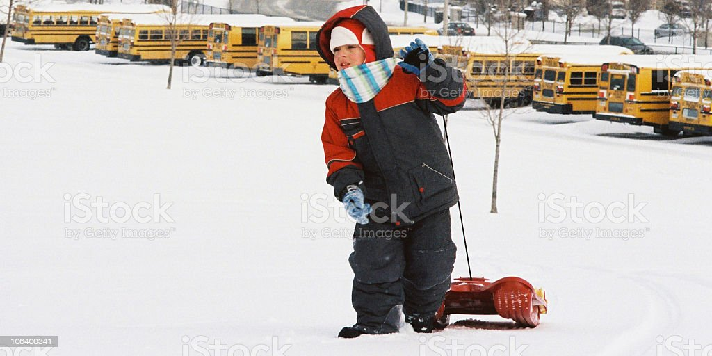 Kid with sled stock photo
