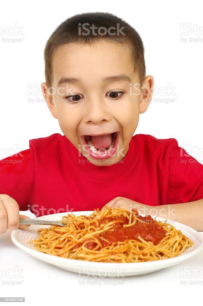 kid with spaghetti stock photo
