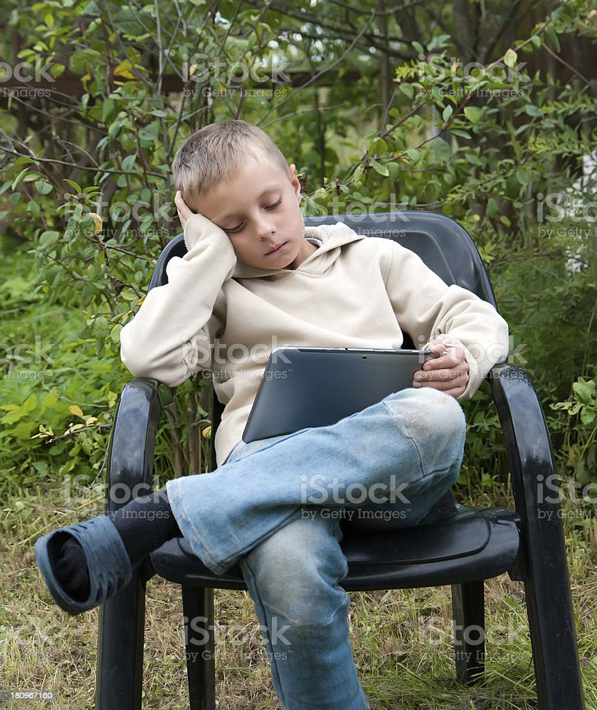 Kid with tablet pc. royalty-free stock photo