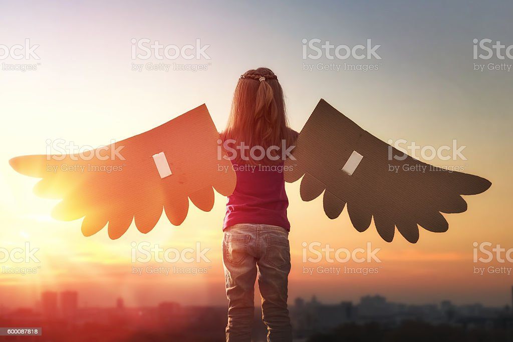Kid with the wings of a bird stock photo