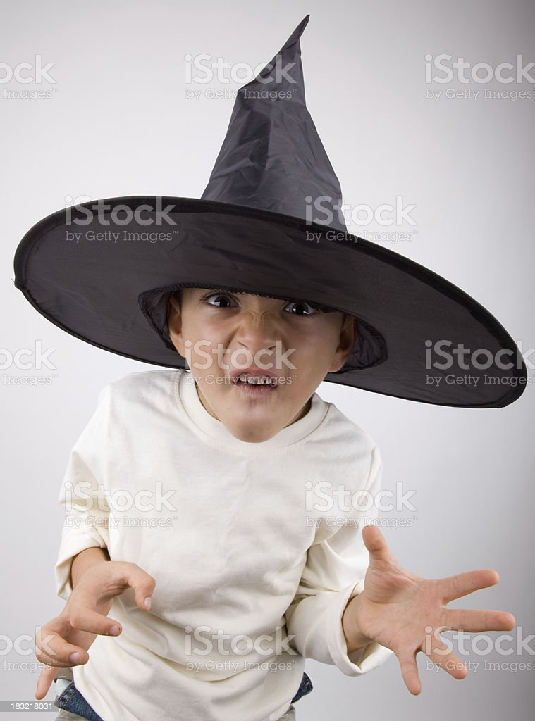 Kid with witch's hat making a face royalty-free stock photo
