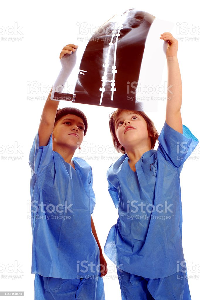 Kid-doctors studying an X-ray royalty-free stock photo