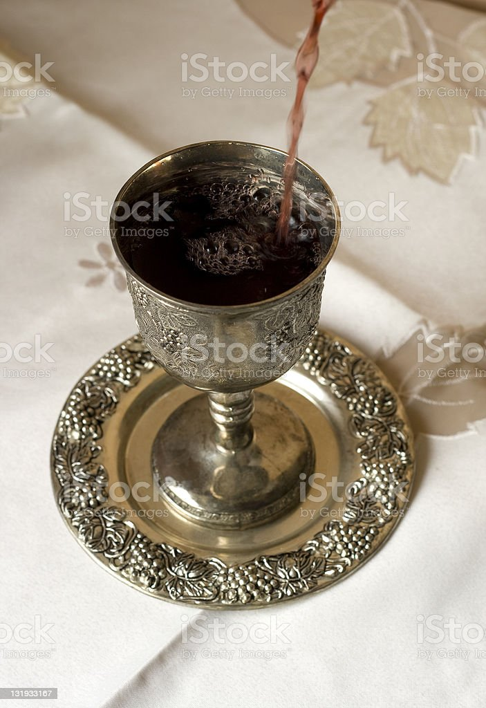 Kiddush cup and wine stock photo
