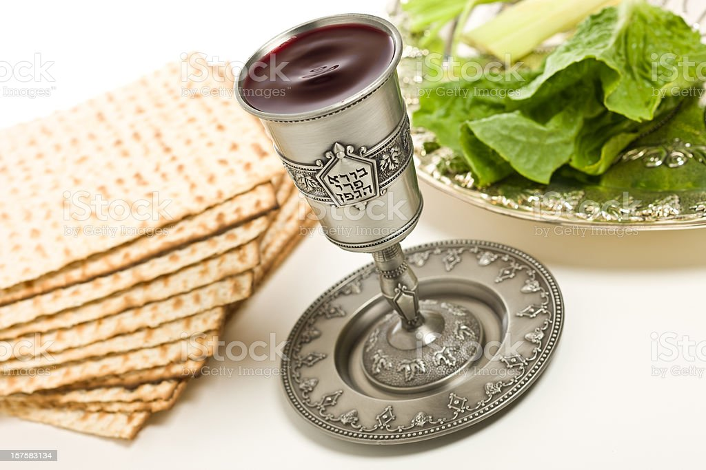 Kiddush cup, Seder plate and matzo for Passover royalty-free stock photo
