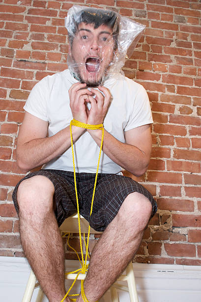 Best Tied Up Men Chair Rope Stock Photos, Pictures