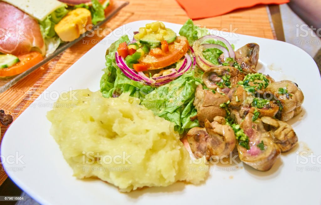 Kidney dish with salad and mashed potatoes stock photo