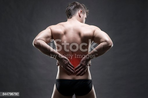 istock Kidney pain. Man with backache. Handsome muscular bodybuilder posing 544796792