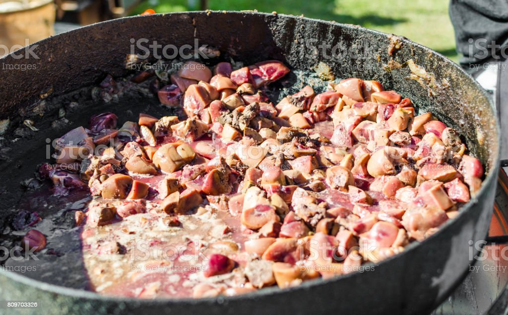 Kidneys frying in a pan at a street food market stock photo