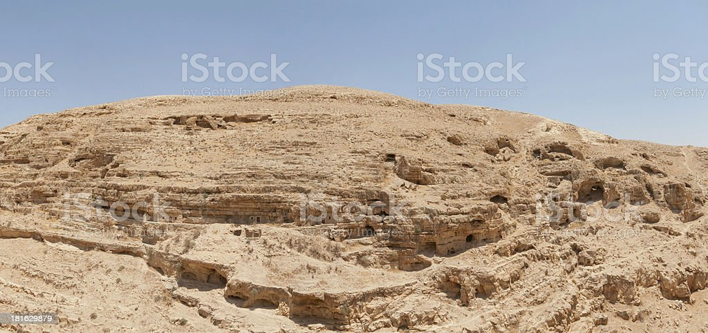 Kidron river canyon with cave monk cell in steep wall royalty-free stock photo