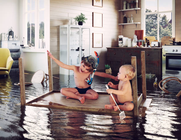 kids and flooding stock photo