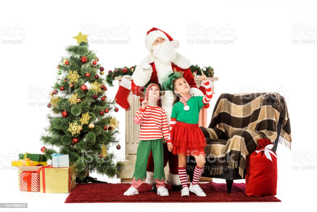 Kids And Santa Standing Near Fireplace And Christmas Tree And Looking Up Isolated On White Stock Photo Download Image Now Istock