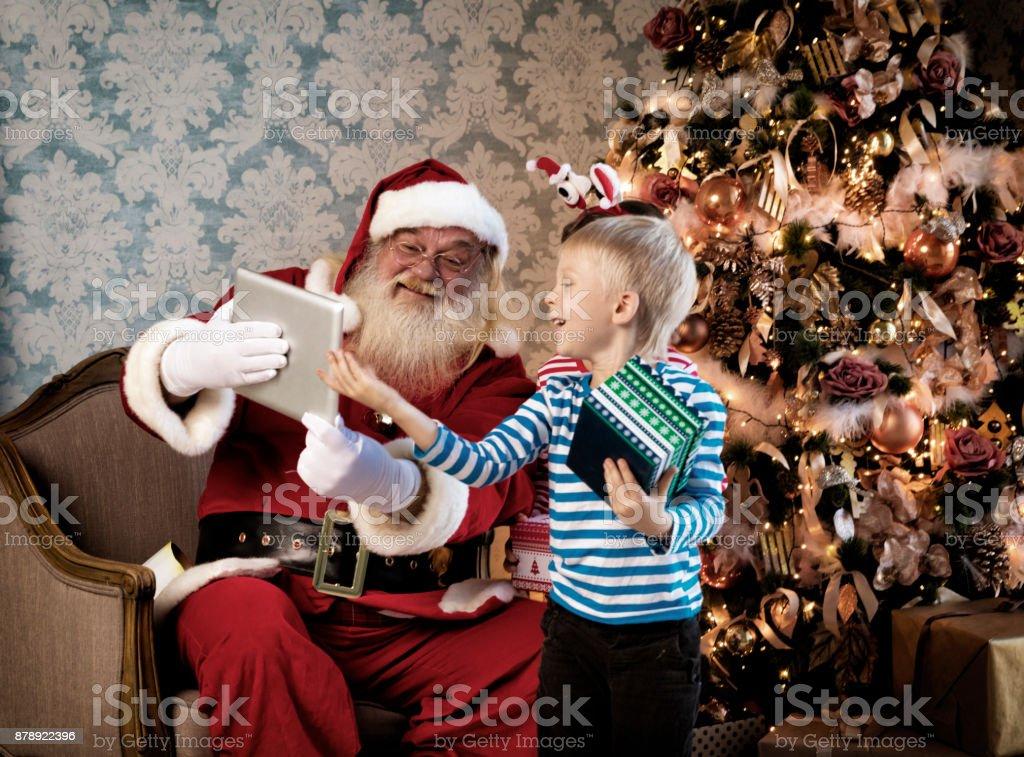 Kids and Santa using digital tablets stock photo